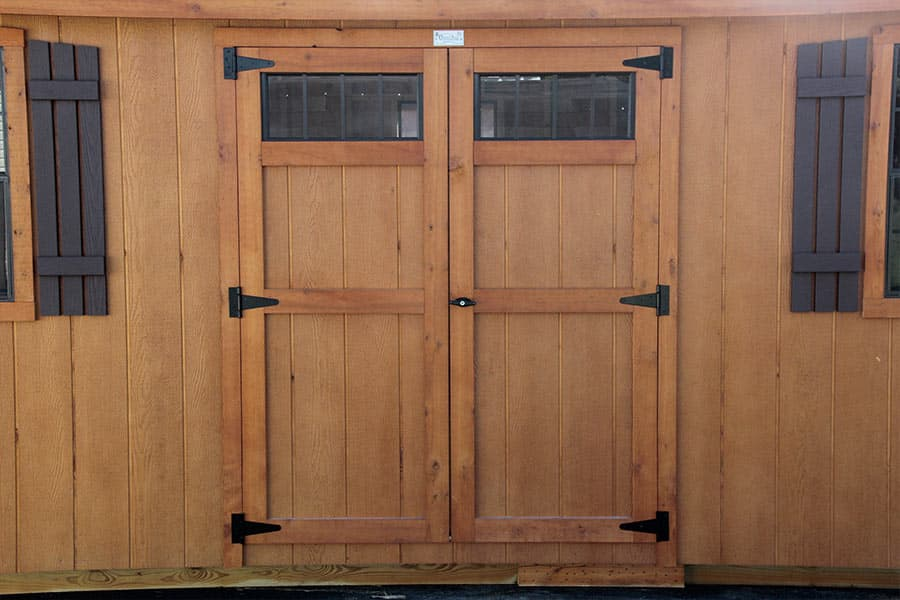 wooden double doors on a shed window