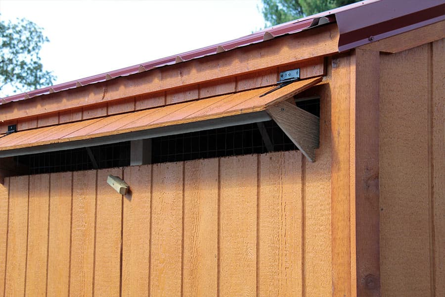 wooden chicken coop with a vent